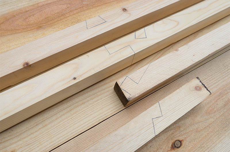 Marking with pencil on parts for wooden slope