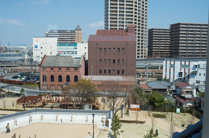 Old block warehouse and Amagasaki station in Hanshin line viewed from observation area